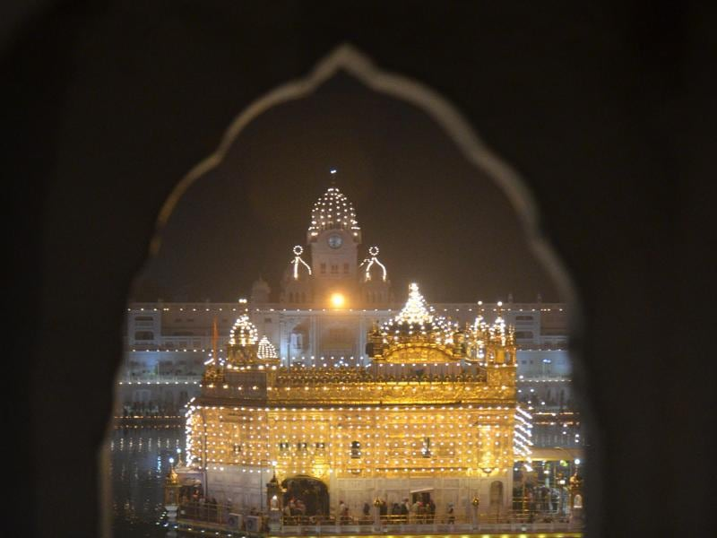 A view of the illuminated Golden Temple from the window of the darbar.  (Sameer Sehgal/HT Photo)