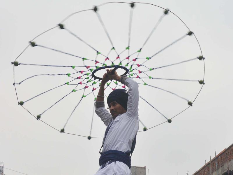 A young religious Sikh warrior performing the Gatka during the procession on  Friday in Amritsar.  (Sameer  Sehgal/HT )