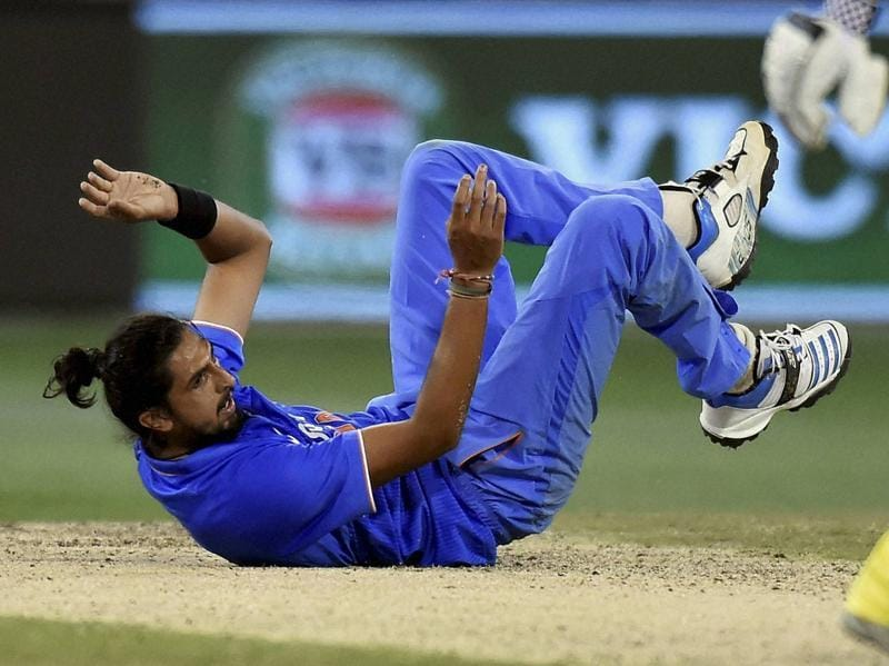 Ishant Sharma falls to the ground after bowling to Australia's James Faulkner. (AP)