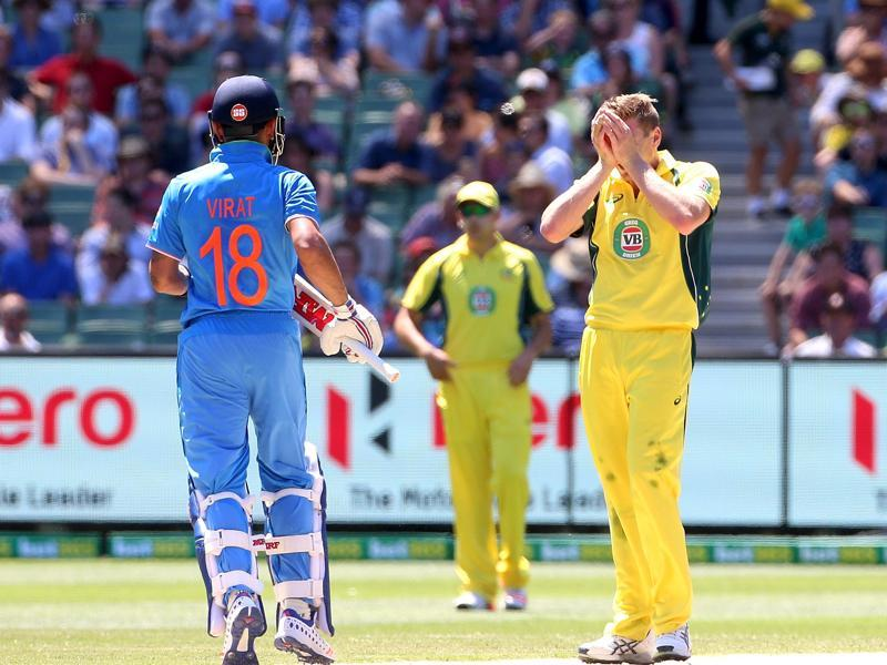 Australia's James Faulkner shows his frustration at a near miss against India's Virat Kohli during their One Day cricket match at the Melbourne Cricket Ground. (REUTERS)