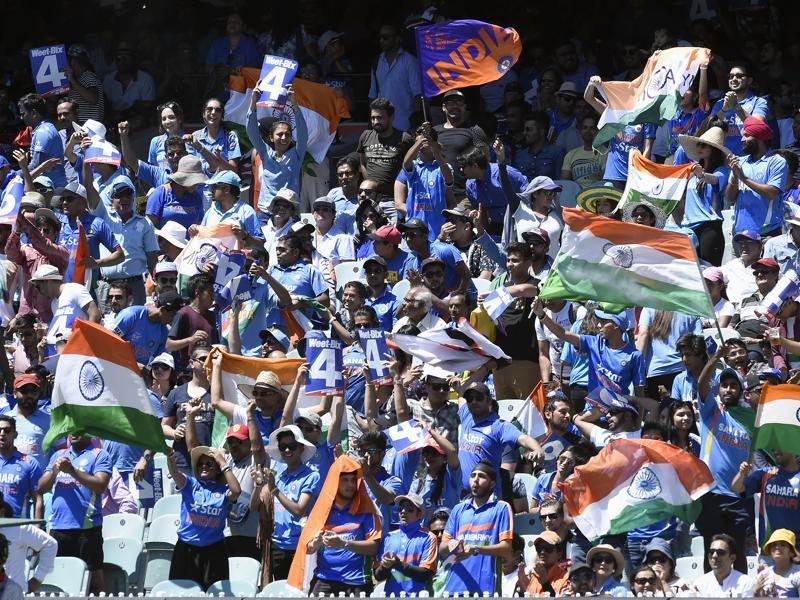 Indian fans cheer their team during their one day international cricket match against Australia in Melbourne. (AP)