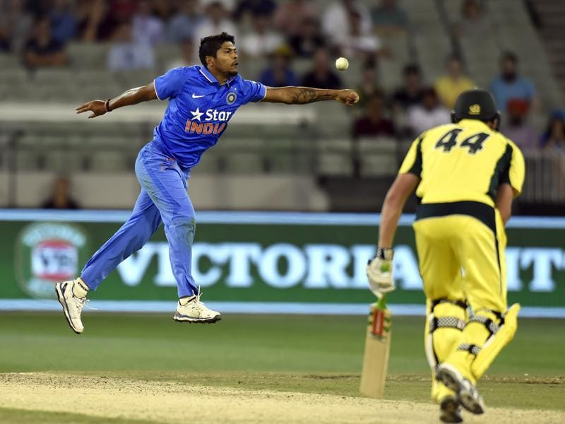 India's Umesh Yadav fields after bowling to Australia's James Faulkner during their one day international cricket match in Melbourne. (AP)