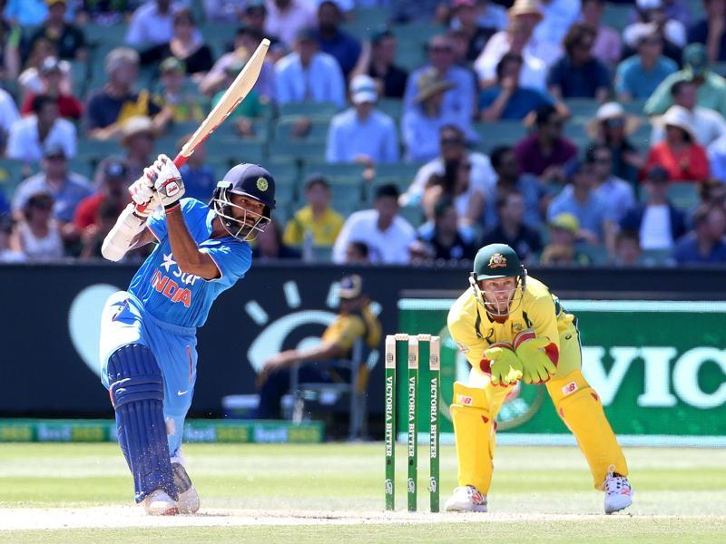 India's Shikhar Dhawan (L) cover drives with Australia's Matthew Wade (R) watching during their One Day cricket match at the Melbourne Cricket Ground. (REUTERS)