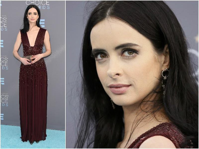 Jessica Jones star Krysten Ritter in a maroon shimmery dress and no fuss make-up