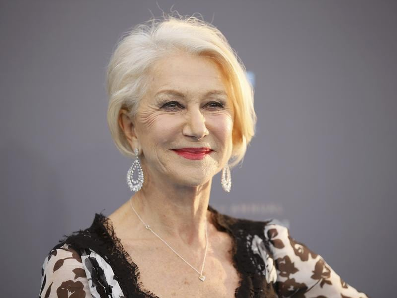 Helen Mirren gives a million dollar smile to the cameras. (REUTERS)