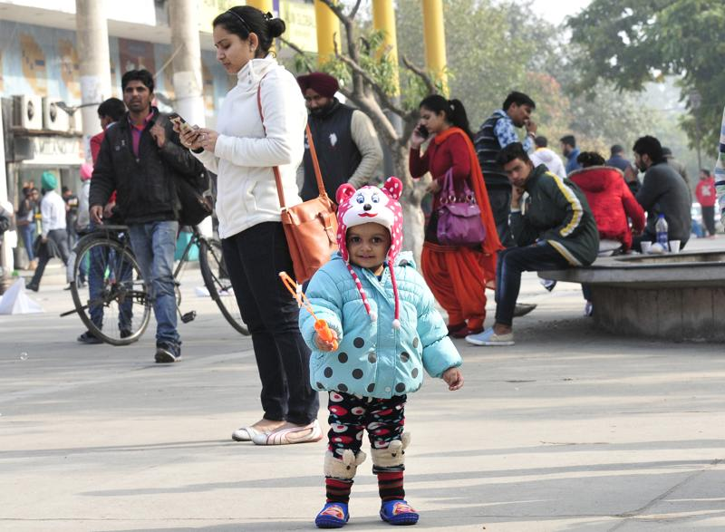 Meanwhile, a child enjoys as the sun finally shines later during the day in Chandigarh. (Keshav SIngh/HT Photo)