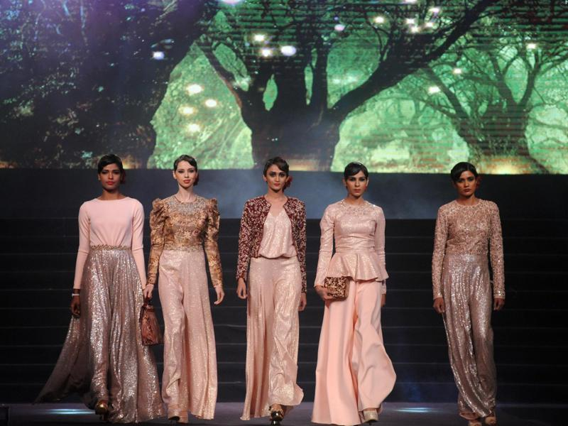 Models showcase creations by designer Vikram Phadnis during the fashion gala. (AFP)