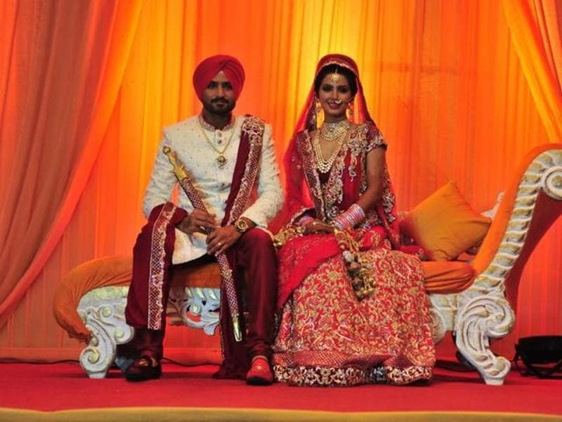 Harbhajan Singh with Geeta Basra pose for shutterbugs after their wedding. (HT Photo)