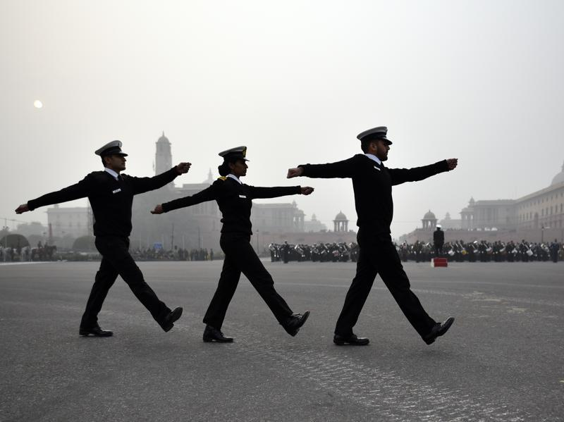 Indian Navy personnel march past during the Beating Retreat parade rehearsal ahead of the Republic Day. (Ravi Choudhary/ HT Photo)