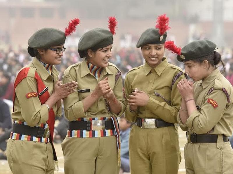 Young NCC cadets  can been seen warming themselves before  they part  in the rehearsals.     (Gurpreet Singh/HT )