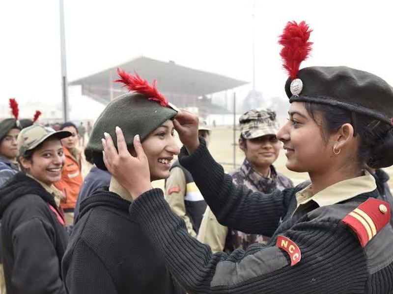 With less than a week to go for January 26, the early morning freeze doesn't seem to stand a chance as these enthusiastic participants rehearse for the Republic Day parade at Guru Nanak Stadium in Amritsar on Wednesday.  A NCC cadets is seen  adjusting  cap of her co -cadet. (Gurpreet Singh/HT )