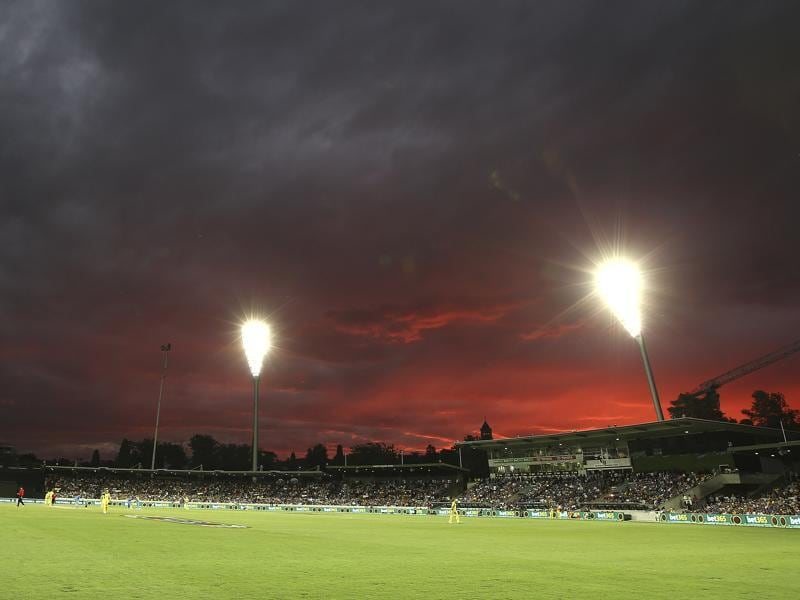 The sky turns red as the sun sets in Canberra. (AP Photo)