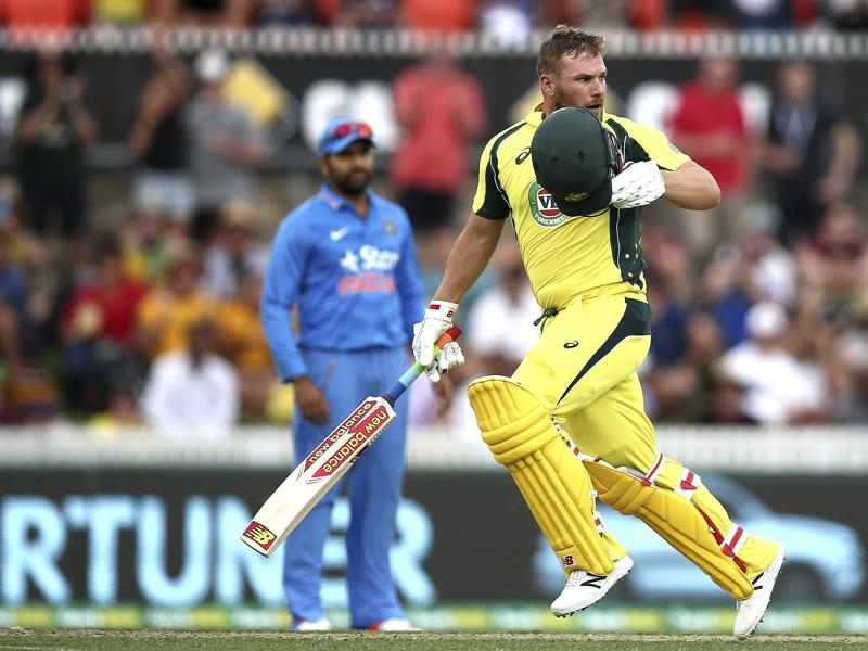 Australian batsman Aaron Finch takes his helmet off to celebrate his century. (AP Photo)