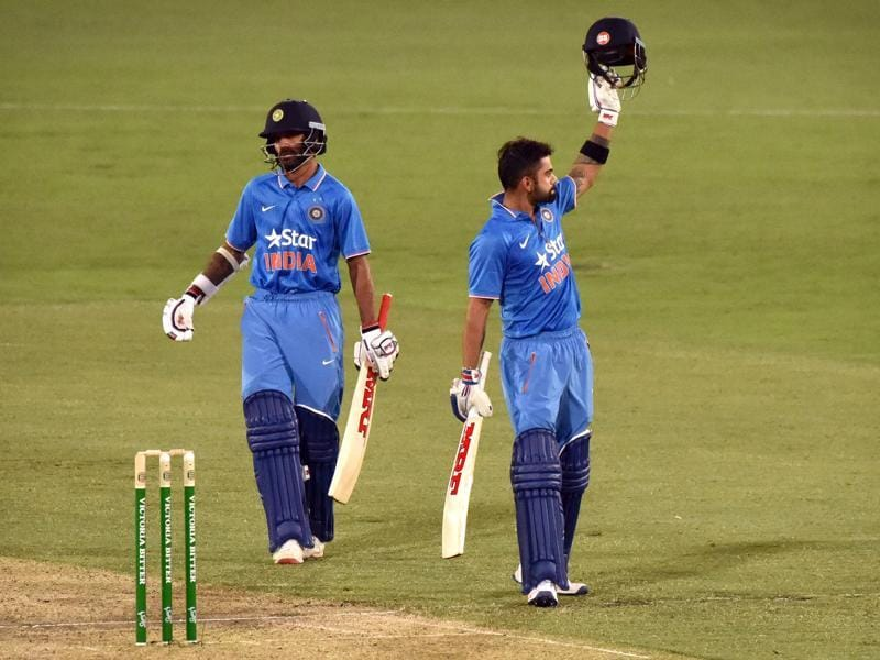 Virat Kohli (R) celebrates his century with partner Shikhar Dhawan. (AFP Photo)