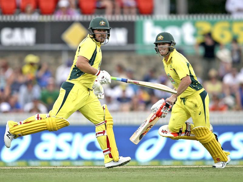 Australian batsman David Warner, right, and Aaron Finch run between the wickets. (AP Photo)