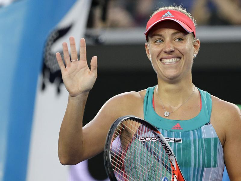 Angelique Kerber of Germany celebrates after defeating Alexandra Dulgheru of Romania in their second round match. (AP Photo)