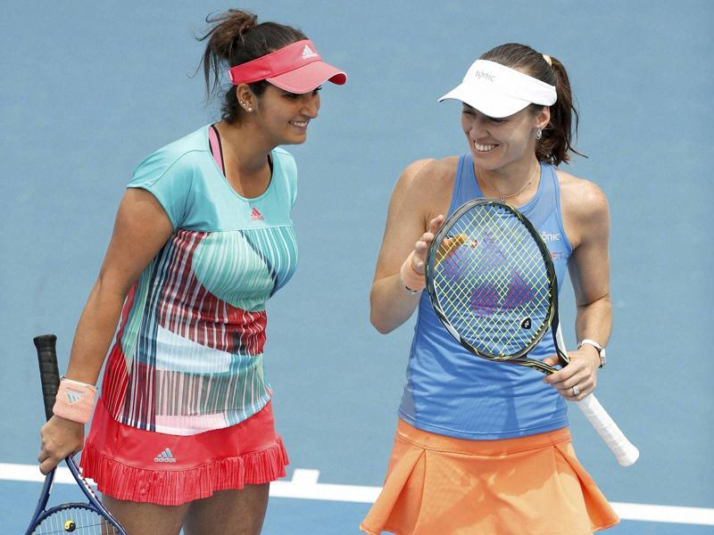 Switzerland's Martina Hingis, right, and India's Sania Mirza celebrate a point during their first round match against Brazil's Teliana Pereira and Colombia's Mariana Duque-Marino. (AP Photo)