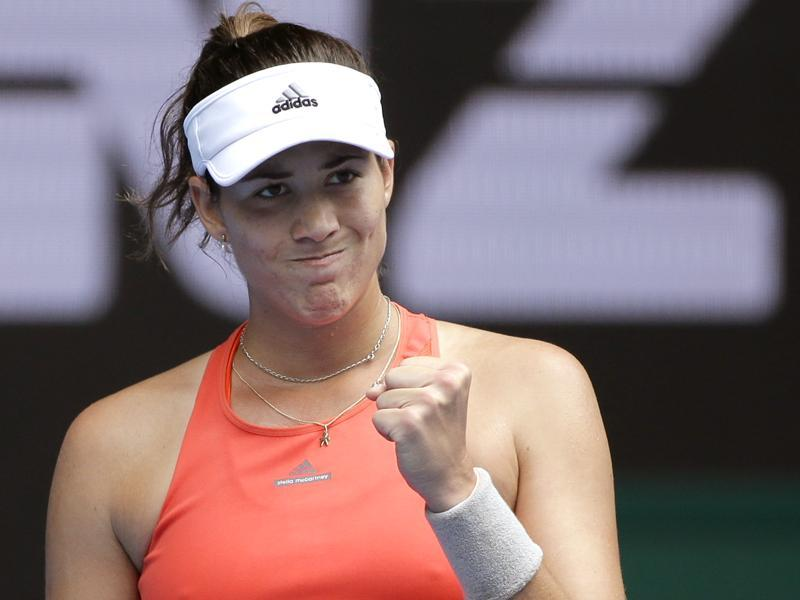Garbine Muguruza of Spain celebrates after defeating Kirsten Flipkens of Belgium in their second round match. (AP Photo)