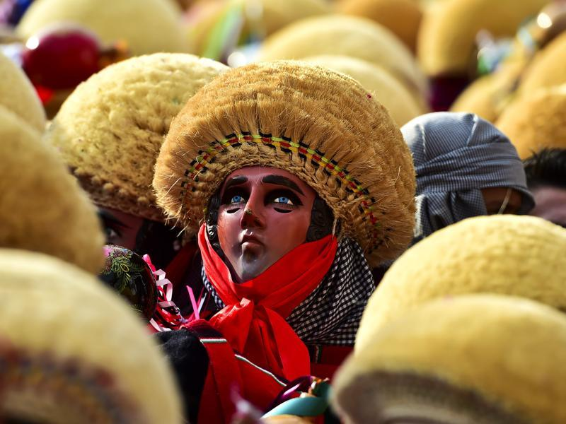 Dancers perform during the celebration of the Parachicos traditional festivity in Chiapa de Corzo, Chiapas State, Mexico on January 20, 2016. The Parachicos is a celebration with pre-Hispanic origins, according to the municipality of Chiapa de Corzo.  (AFP)