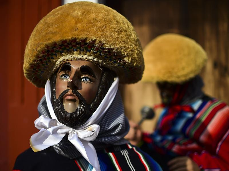 A masked man poses during the Parachicos celebration in Mexico. (AFP)