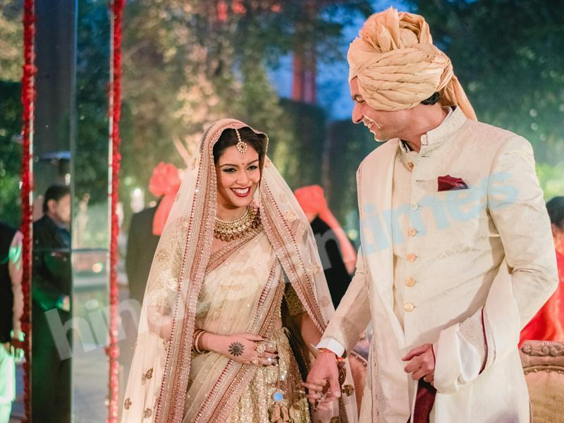 Asin looked stunning in her Sabyasachi lehenga at the Hindu wedding ceremony with husband Rahul Sharma who was not looking so bad either. (Stories by Joseph Radhik)
