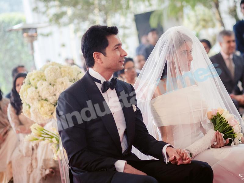 Rahul Sharma and Asin in her flowing Vera Wang gown at the morning's Christian ceremony. (Stories by Joseph Radhik)