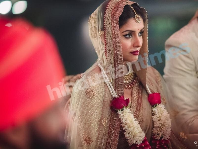 Asin in her Sabyasachi lehenga at the evening's Hindu wedding ceremony. (Stories by Joseph Radhik)