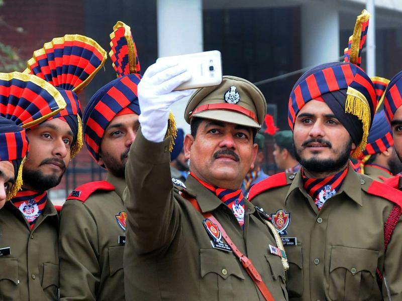 Punjab Police personnel taking a selfie during their full dress rehearsal of the Republic Day parade. (Karun Sharma/HT Photo)
