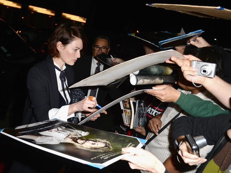 Actor Lena Headey attends the premiere of Screen Gems' Pride and Prejudice and Zombies and is  hounded for autographs. (AFP)