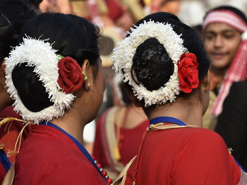 Assamese women with their hair done up prepare for a  traditional dance. (Ajay Aggarwal/ HT Photo)