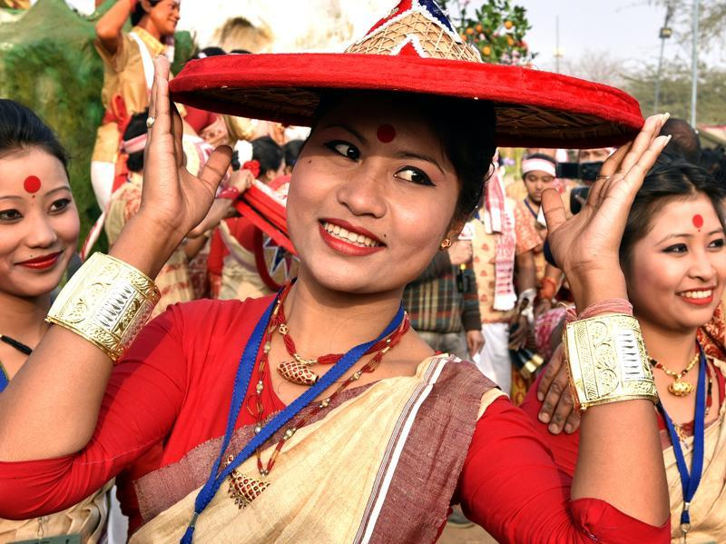 A participant from Assam poses for a picture in her traditional attire.  (Ajay Aggarwal/ HT Photo)