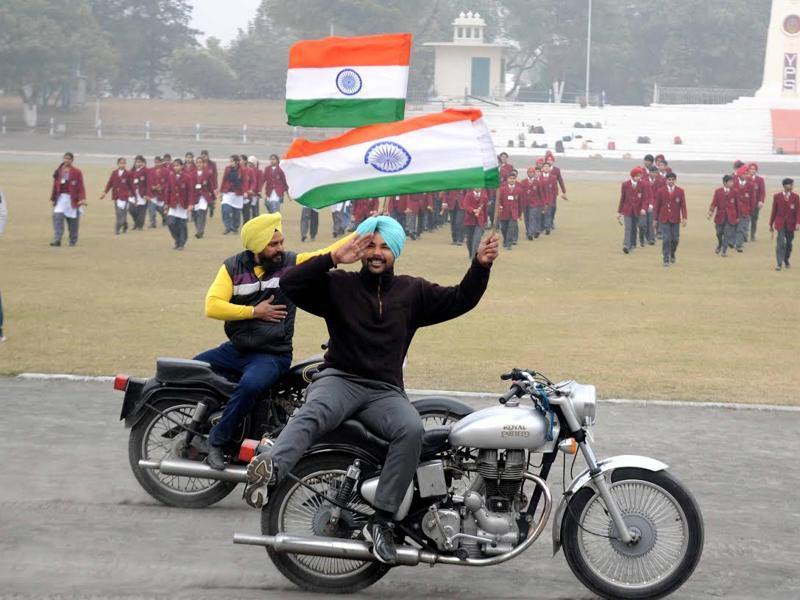 Young bikers perform stunts while rehearsing for the parade in Patiala on Saturday.  (Bharat Batish/HT Photo)