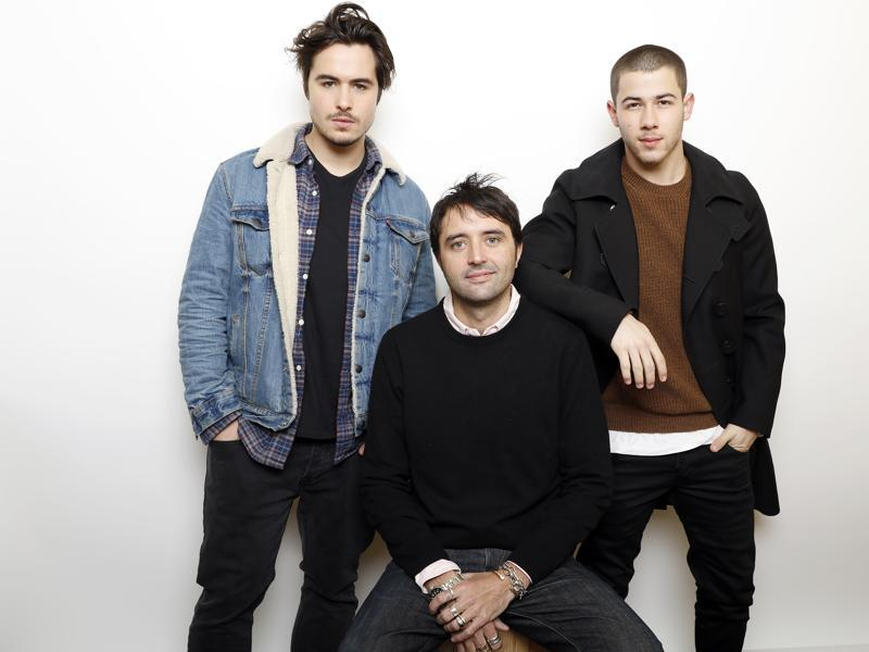 Actors Ben Schnetzer, left, and Nick Jonas pose with director Andrew Neel, centre, for a portrait to promote the film, Goat, during the Sundance Film Festival in Park City, Utah.  (AP)