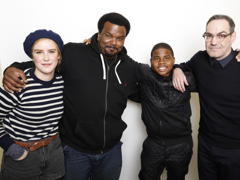 From left, actors Carla Juri, Craig Robinson, and Markees Christmas pose with filmmaker Chad Hartigan for a portrait to promote the film, Morris From America, at the Toyota Mirai Music Lodge during the Sundance Film Festival. (AP)