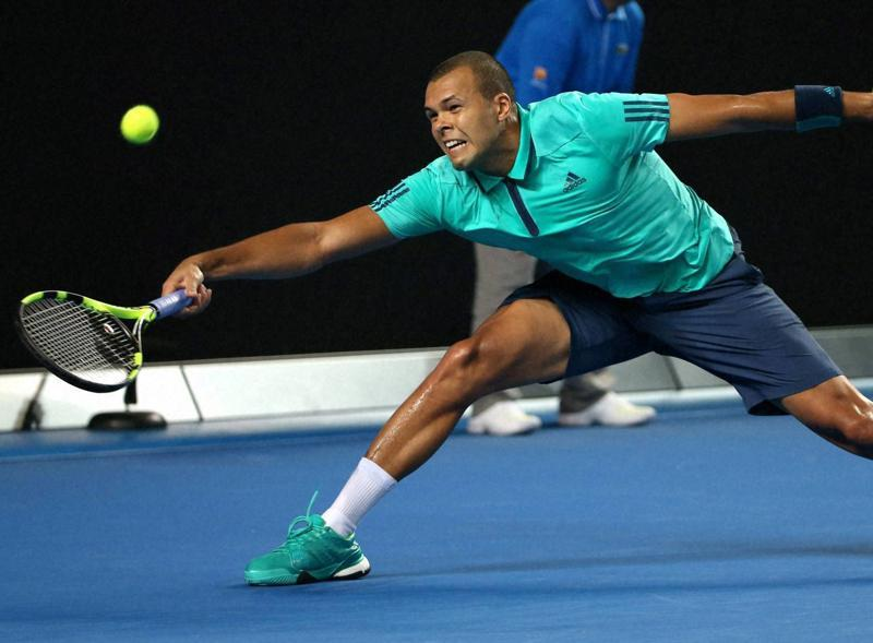 Jo-Wilfried Tsonga of France reaches for a forehand return during his fourth round match against Kei Nishikori of Japan. (AP Photo)