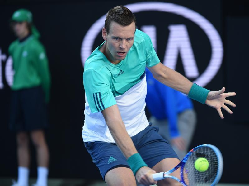 Czech Republic's Tomas Berdych plays a backhand return during his men's singles match against Spain's Roberto Bautista Agut. (AFP Photo)