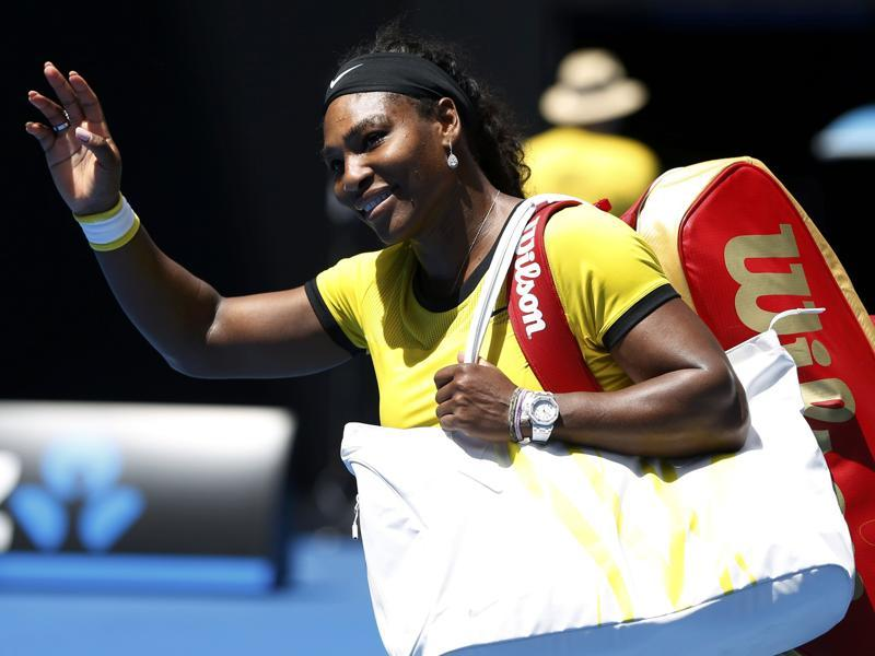 Serena Williams of the U.S. waves as she leaves after winning her fourth round match against Russia's Margarita Gasparyan at the Australian Open. (Reuters Photo)