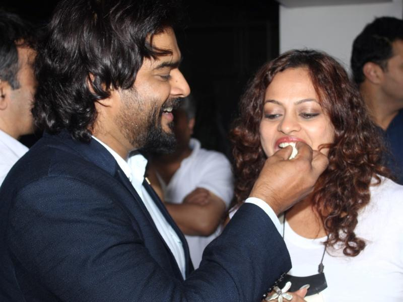 R Madhavan with wife Sarita Birje during the special screening of Saala Khadoos. (IANS)