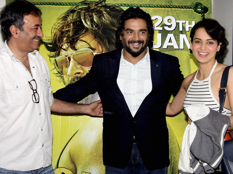 R Madhavan and Kangana Ranaut with filmmaker Rajkumar Hirani during the screening of Saala Khadoos, in Mumbai.  (PTI)