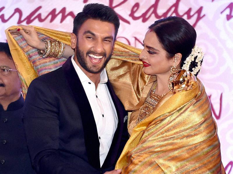 Bollywood actor Ranveer Singh felicitates veteran actor Rekha during the 3rd Yash Chopra Memorial award which was conferred to her in Mumbai on Monday.  (PTI)