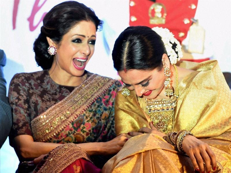 Actors Sridevi and Rekha share a light moment during the latter's felicitation ceremony during the 3rd Yash Chopra Memorial awards. (PTI)