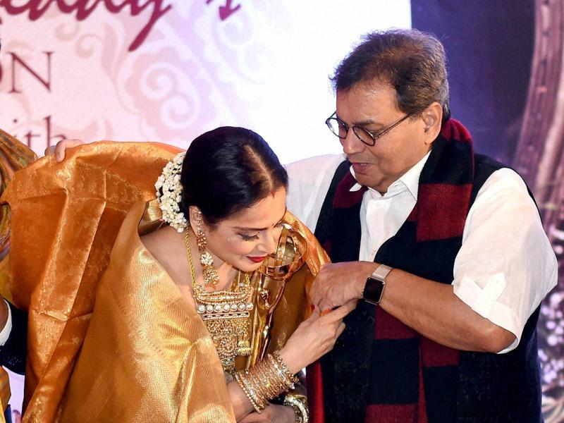 Filmmaker Subhash Ghai felicitates veteran star Rekha during the 3rd Yash Chopra Memorial award which was conferred to her in Mumbai. (PTI)