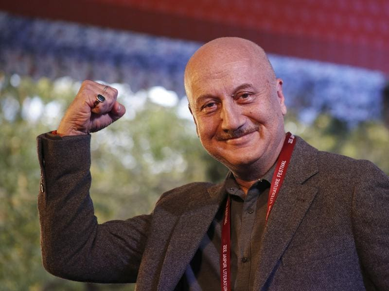 Bollywood actor Anupam Kher strikes a pose for the audience at the Jaipur Literature Festival at Jaipur.  (AP Photo/ Deepak Sharma)