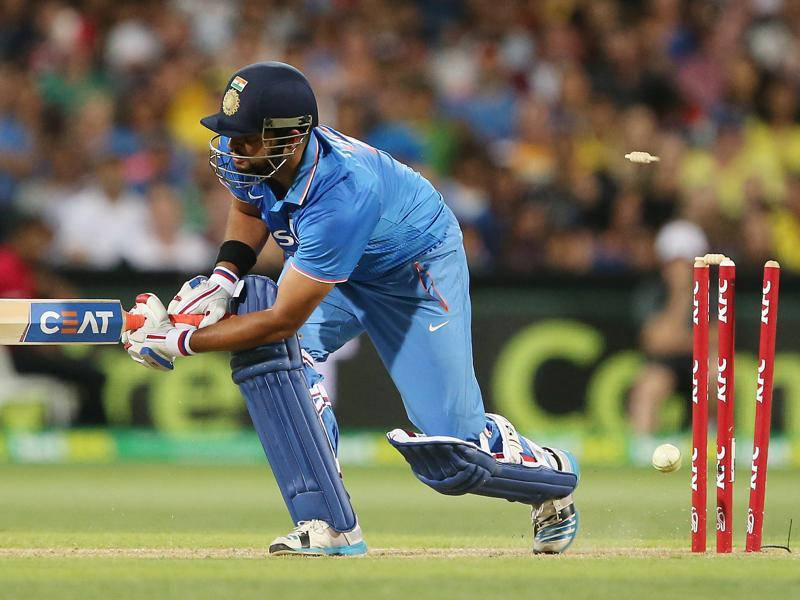 India's Suresh Raina is bowled during their T20 International cricket match against Australia. (AP Photo)