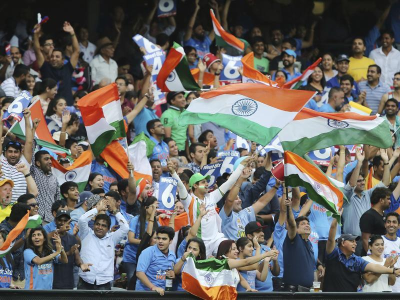 India's fans react during the T20 International cricket match between Australia and India. (AP Photo)