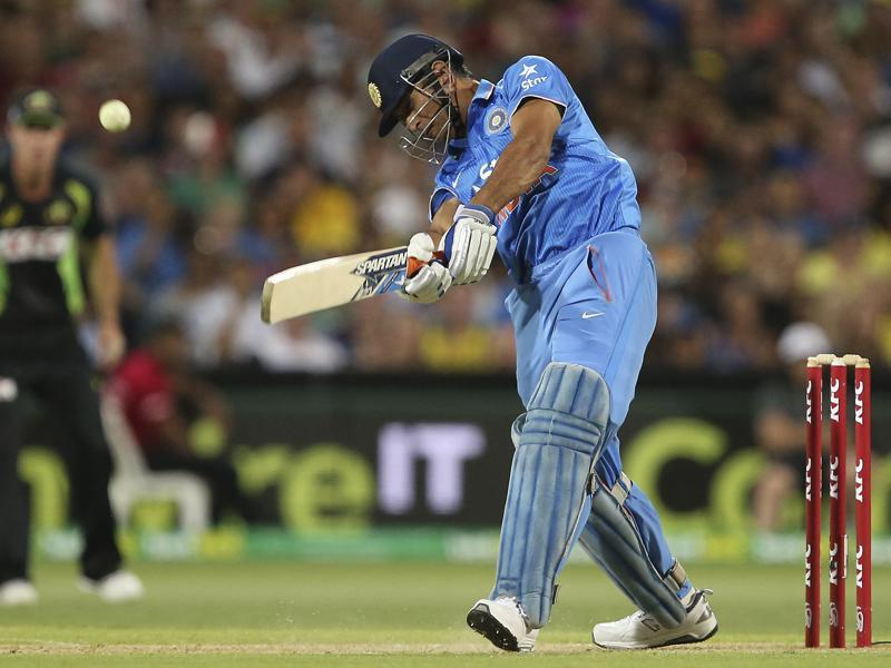 India's MS Dhoni hits a six during their T20 International cricket match against Australia.  (AP Photo)