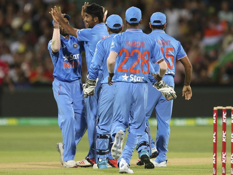 India players celebrate the wicket of Australia's David Warner. (AP Photo)