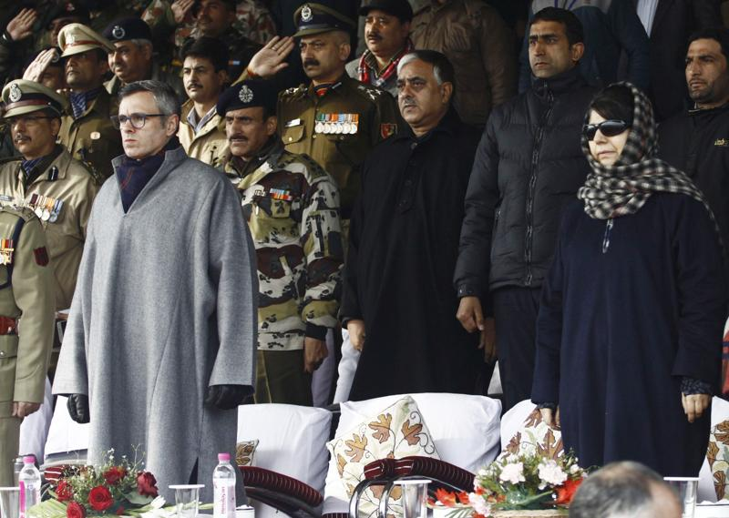 PDP president Mehbooba Mufti and former J-K chief minister Omar Abdullah during India's 67th Republic Day celebrations in Srinagar. (Waseem Andrabi/HT Photo)