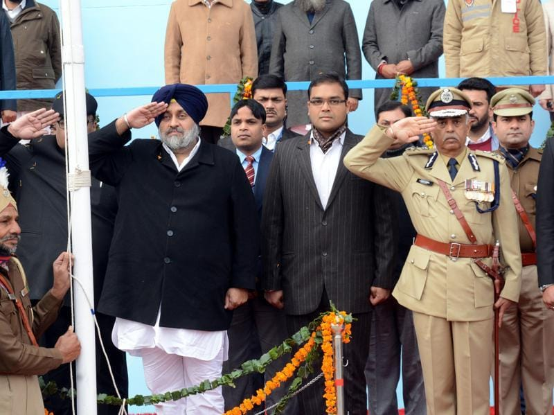 Punjab deputy chief minister Sukhbir Singh Badal salutes the national flag at the Republic Day function in Bathinda on Tuesday. The function, held at the multi purpose sports stadium, was a colourful event tinged with patriotic fervour.Photo by Sanjeev Kumar/Hindustan Times.  (Sanjeev Kumar/HT Photo)