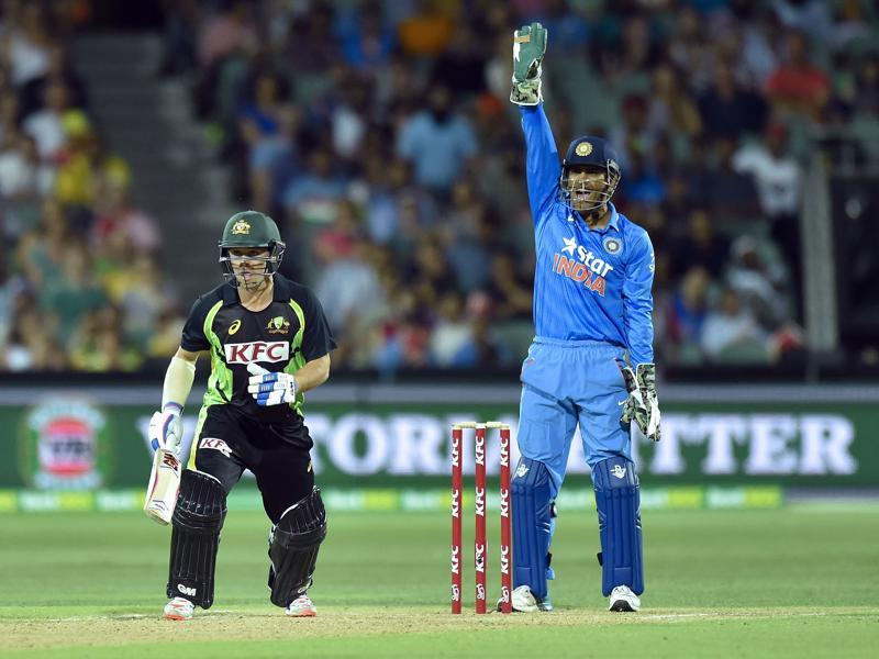 MS Dhoni of India  appeals for the dismissal of Travis Head of Australia. (AFP Photo)